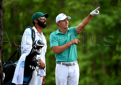 07.04.2016. Augusta, GA, USA. Jordan Spieth, right, explains his shot from the rough along the 11th fairway to his caddie, Michael Greller, left, during the first round of the Masters Golf Tournament on Thursday, April 7, 2016, at Augusta National Golf Club in Augusta, Ga