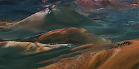 The multi colored landscape of the crater in HALEAKALA NATIONAL PARK on Maui in Hawaii is dominated by lava flows and cinder cones.
