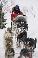 Paul Gebhardt on Trail in Snow Storm Iditarod 2005 AK after Rainy Pass Chkpt