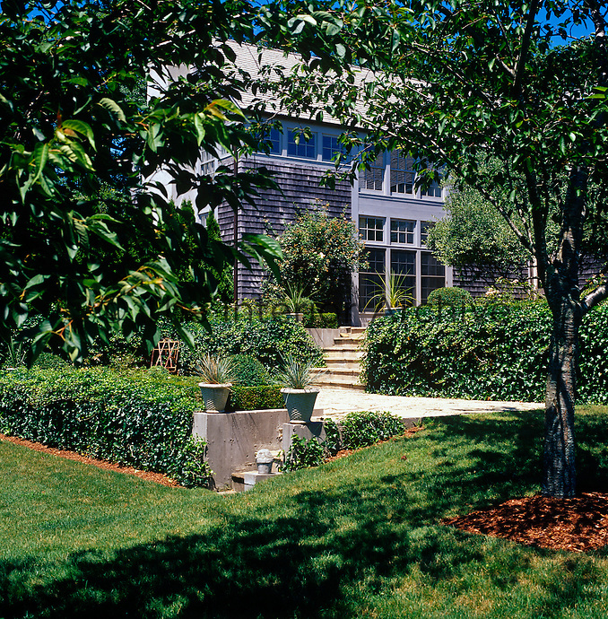 The clapboard exterior of this contemporary home in The Hamptons viewed from the garden
