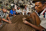 Local Manggarai workers sift through excavated soil spit-by-spit in search of tiny remains at Liang Bua cave, discovery site of the Flores hobbit, Homo floresiensis