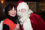 Patricia Rooney, President of Drogheda Chamber of Commerce  shares a magic moment with Santa Claus at the switching on of the Christmas lights on West Street, last Friday.