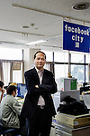 Taeko city, January 15 2013 - Portrait of the Mayor Keisuke Hiwatashi in front of the Facebook desk at the city hall.