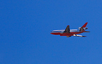 DC 10 approaches the Apple Canyon area of Mountain Center fire to drop fire retardanton July 16, 2013.