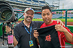 """9 June 2013: I'm presented with a gift from Washington Nationals Training Assistant John Hsu prior to a game against the Minnesota Twins at Nationals Park in Washington, DC. The Korean writing depicts """"Victory"""" which the Nationals accomplished by shutting out the Twins 7-0 in the first game of their Day-Night Double-Header."""