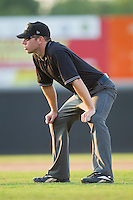 Umpire Bryan Fields handles the calls on the bases during the South Atlantic League game between the Greensboro Grasshoppers and the Hickory Crawdads at  L.P. Frans Stadium July 10, 2010, in Hickory, North Carolina.  Photo by Brian Westerholt / Four Seam Images