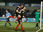 Bilel Mohsni celebrates his goal with Jon Daly and Seb Faure on his back