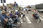 Hanoi-Vietnam, Ha Noi - Viet Nam - 24 July 2005---Motorbike taxis waiting for clients at a junction---transport, traffic, people, urban---Photo: Horst Wagner/eup-images