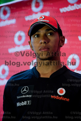 McLaren Formula One driver Lewis Hamilton of Britain visits a Vodafone press conference just prior to the Hungarian F1 Grand Prix in Budapest, Hungary. Thursday, 28. July 2011. ATTILA VOLGYI