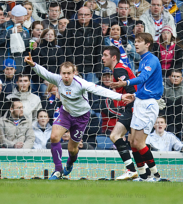 Jamie Hamill scores for Kilmarnock as he knocks the ball past Allan McGregor and runs off to celebrate