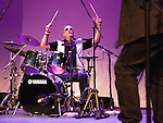 Ron Neuhauser plays the drums onstage for an informal jam session at the end of the First Annual Veterans Benefit Jam:  Vet Jam 2013 at the California Theatre in Pittsburg, California on Saturday, November 9, 2013.  Photo/Victoria Sheridan