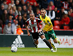 Samir Carruthers of Sheffield Utd and Tom Trybull of Norwich City during the Championship match at Bramall Lane Stadium, Sheffield. Picture date 16th September 2017. Picture credit should read: Simon Bellis/Sportimage