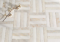 Cabin Weave Grand, a hand-cut stone mosaic, shown in Venetian honed Thassos and Cloud Nine, is part of the Tissé® collection for New Ravenna.