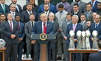 New England Patriots head coach Bill Belichick, left, and  owner Robert Kraft, center right, and his son, Jonathan Kraft, right, listen as United States President Donald J. Trump, center left, welcomes the Super Bowl Champion New England Patriots to the South Lawn of White House in Washington, DC on Wednesday, April 19, 2917.<br /> Credit: Ron Sachs / CNP/MediaPunch<br /> <br /> (RESTRICTION: NO New York or New Jersey Newspapers or newspapers within a 75 mile radius of New York City)