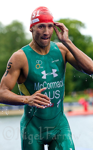 07 AUG 2011 - LONDON, GBR - Chris McCormack (AUS) leaves the water at the end of the swim during the men's round of triathlon's ITU World Championship Series (PHOTO (C) NIGEL FARROW)