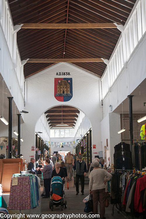 Shoppers inside the historic Shambles market hall in Devizes, Wiltshire, England