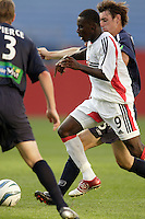 D.C. United's Freddy Adu attempts to split the defense of the New England Revolution's Rusty Pierce and Andy Dorman. The New England Revolution and D.C. United finished in a scoreless tie in MLS play at Gillette Stadium, Foxboro, MA on Saturday August 28, 2004.