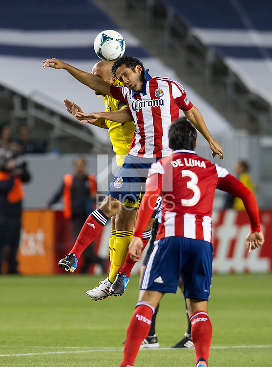 CARSON, CA - March 2, 2013: Chivas midfielder Edgar Mejia (8) during the Chivas USA vs Columbus Crew match at the Home Depot Center in Carson, California. Final score, Chivas USA 0, Columbus Crew 3.
