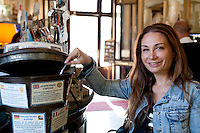Simona Amalfitano, from Naples, buys a caffe sospeso at Caffe Gambrinus, Naples, Italy