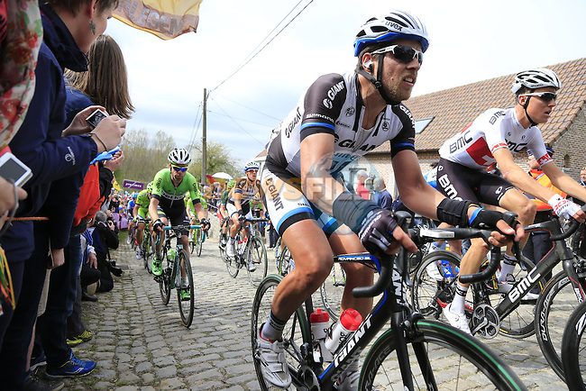 The peleton, including Bert De Backer (BEL) Team Giant-Shimano, climb the Molenberg during the 2014 Tour of Flanders, Belgium.<br /> Picture: Eoin Clarke www.newsfile.ie