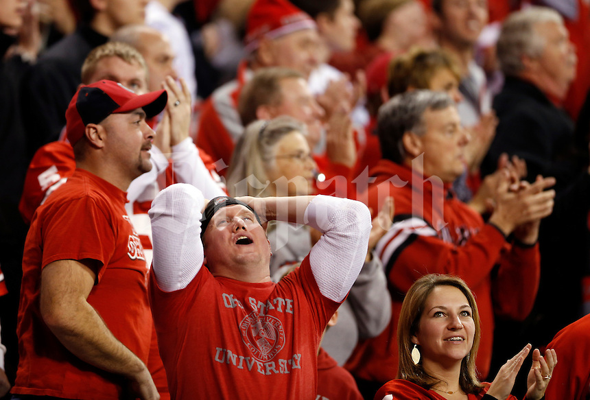 Ohio State fan and Newark, Ohio native Weiant Williams, now of Chicago, reacts to a long run by Ohio State Buckeyes quarterback Braxton Miller (5) that nearly resulted in a touchdown during the second quarter of the Big Ten championship football game at Lucas Oil Stadium in Indianapolis on Dec. 7, 2013. (Adam Cairns / The Columbus Dispatch)