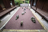 """Ryugin-an Eastern garden is the """"Garden of the Inseparable"""".  This garden uses purple gravel that is not common for zen gardens, an indicator of the modernity of its design.  Ryugin-an gardens were designed by Shigemori Mirei the renowned landscape architect and garden designer who designed other gardens at Tofukuji, as well as other venues in Kyoto and elsewhere in Japan."""