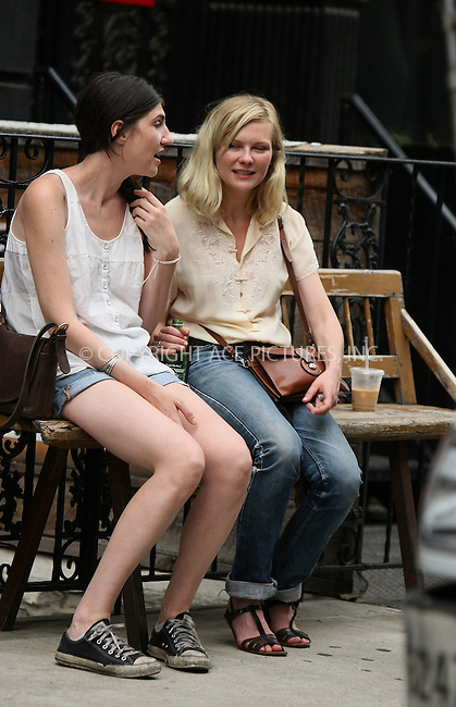 WWW.ACEPIXS.COM . . . . .  ....Exclusive - all rounder....June 1 2011, New York City....Actress Kirtsen Dunst (R), who was recently awarded Best Actress Award at the Cannes Film Festival 2011 for her performance in Lars von Trier's Melancholia, was spotted with a friend outside a cafe in Soho on June 1 2011 in New York City....Please byline: PHILIP VAUGHAN - ACE PICTURES.... *** ***..Ace Pictures, Inc:  ..Philip Vaughan (212) 243-8787 or (646) 679 0430..e-mail: info@acepixs.com..web: http://www.acepixs.com