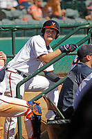 University of Virginia Cavaliers infielder Pavin Smith (10) in the dugout during a game against the Liberty University Flames at Joseph P. Riley Ballpark on February 17, 2017 in Charleston, South Carolina. Virginia defeated Liberty 10-2. (Robert Gurganus/Four Seam Images)