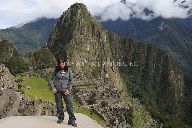 "WWW.ACEPIXS.COM . . . . . .January 8, 2013...Peru...Huayna Picchu also known as Wayna Picchu (Quechua: ""Young Peak"") is a mountain in Peru around which the Urubamba River bends. It rises over Machu Picchu, the so-called lost city of the Incas, and divides it into sections. The Incas built a trail up the side of the Huayna Picchu and built temples and terraces on its top. The peak of Huayna Picchu is about 2,720 metres (8,920 ft) above sea level, or about 360 metres (1,180 ft) higher than Machu Picchu...January 8, 2013 in Peru ....Please byline: KRISTIN CALLAHAN - ACEPIXS.COM.. . . . . . ..Ace Pictures, Inc: ..tel: (212) 243 8787 or 212 489 0521..e-mail: kristincallahan@aol.com...web: http://www.acepixs.com ."
