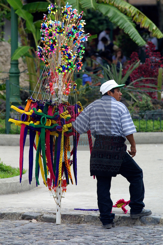 A vendor in the central park in Antigua, Guatemala.