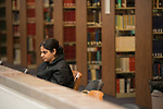 Second year Ph.D. student Sumedha Therthani works in the library.  Photo by Kevin Bain/University Communications Photography