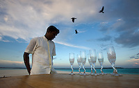 November 27th, 2008_MALDIVES_ Workers at the Soneva Fushi resort island in the Baa Atoll, Maldives, prepare for a cocktail party on a small sand island nearby.  Soneva Fushi is a leader in green practices and plans to be carbon neutral by 2010 by implementing projects such as a deep-sea water cooling system to replace it's traditional air conditioners.  Photographer: Daniel J. Groshong/Tayo Photo Group