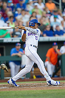Florida Gators outfielder Buddy Reed (23) follows through on his swing against the Coastal Carolina Chanticleers in Game 4 of the NCAA College World Series on June 19, 2016 at TD Ameritrade Park in Omaha, Nebraska. Coastal Carolina defeated Florida 2-1. (Andrew Woolley/Four Seam Images)