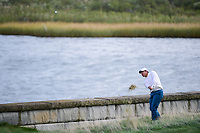 Hideki Matsuyama (JPN) hits his approach shot on 14 during round 3 Four-Ball of the 2017 President's Cup, Liberty National Golf Club, Jersey City, New Jersey, USA. 9/30/2017.<br /> Picture: Golffile | Ken Murray<br /> <br /> All photo usage must carry mandatory copyright credit (&copy; Golffile | Ken Murray)