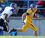 BROOKINGS, SD - OCTOBER 26:  Zach Zenner #31 from South Dakota State University turns the corner past Deiondre' Hall #1 from Northern Iowa for a touchdown in the third quarter of their game Saturday afternoon at Coughlin Alumni Stadium in Brookings. (Photo by Dave Eggen/Inertia)