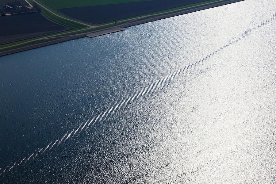Nederland, Flevoland, Ketelmeer, 01-05-2013; Rimpels vormen spoor van boot in water voor de kust van Flevoland.<br /> The water glistens by the late sunshine on the surface. <br /> luchtfoto (toeslag op standard tarieven)<br /> aerial photo (additional fee required)<br /> copyright foto/photo Siebe Swart