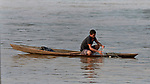 An indigenous man fishes in the Javari River at Atalaia do Norte in Brazil's Amazon region.