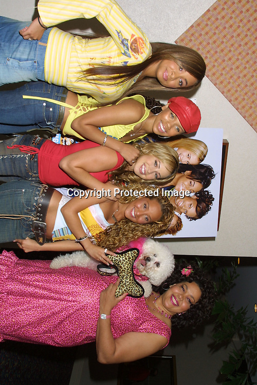 "©2003 KATHY HUTCHINS / HUTCHINS PHOTO.TELEVISION CRITICS TOUR.CABLE SESSION.HOLLYWOOD, CA.JULY 8, 2003..""THE CHEETAH GIRLS"" CAST..ADRIENNE BAILON, KIELY WILLIAMS, SABRINA BRYAN,  RAVEN SIMONE,  AND DEBORAH GREGORY WITH HER DOG CAPPUCCINO."