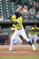 Center fielder Gerson Molina (12) of the Columbia Fireflies bats in a game against the Augusta GreenJackets on Thursday, July 11, 2019 at Segra Park in Columbia, South Carolina. Columbia won, 5-2. (Tom Priddy/Four Seam Images)