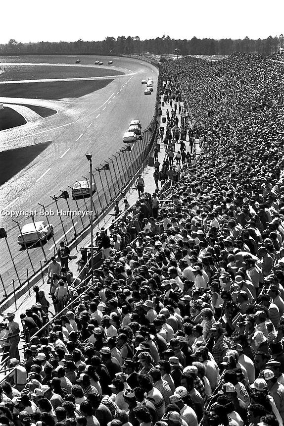 DAYTONA BEACH, FL - FEBRUARY 16: A group of cars race toward Turn 1 during the Daytona 500 NASCAR Winston Cup race at the Daytona International Speedway in Daytona Beach, Florida, on February 16, 1986.