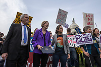 United States Representative Lloyd Doggett (Democrat of Texas), left, United States Senator Elizabeth Warren (Democrat of Massachusetts), center, and progressive activist Nicole Gill, right, wait to speak during a rally led by Congressional Democrats against United States President Donald J. Trump's proposed tax plan outside the United States Capitol in Washington, D.C. on November 1st, 2017.<br /> Credit: Alex Edelman / CNP /MediaPunch
