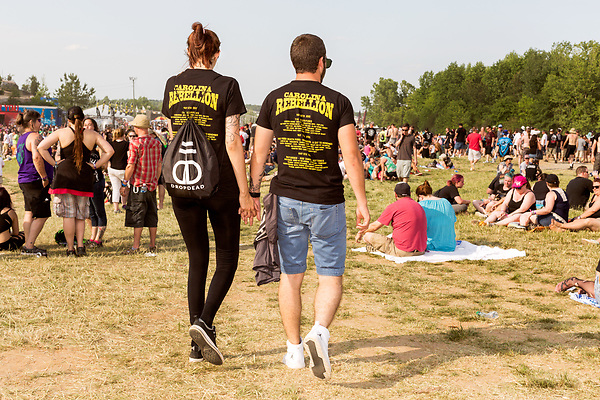 May 8, 2016. Concord, North Carolina. <br />  Young love at the Carolina Rebellion.<br />  The 2016 Carolina Rebellion was held over May 6-8 next to the Charlotte Motor Speedway and featured over 50 bands including headliners Lynyrd Skynyrd, The Scorpions, Five Finger Death Punch, Disturbed, and Rob Zombie.