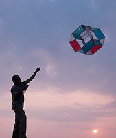 Local man flying a kite on the promenade in Galle, Sri Lanka