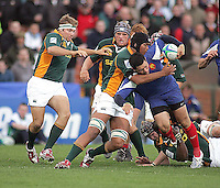 South African number 8 Cornell Hess tackles French centre Yann David during the first half of the Division A clash against France at Ravenhill.