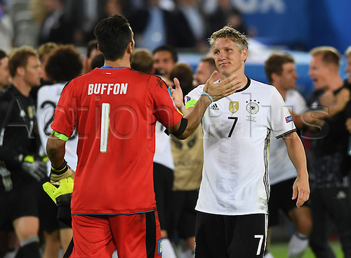02.07.2016. Bordeaux, France.  Germany's Bastian Schweinsteiger (R) shake hands with Italy's goalkeeper Gianluigi Buffon after the UEFA EURO 2016 quarter final soccer match between Germany and Italy at the Stade de Bordeaux in Bordeaux, France, 02 July 2016.