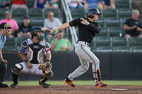 Preston Palmeiro (25) of the Delmarva Shorebirds follows through on his swing against the Kannapolis Intimidators at Kannapolis Intimidators Stadium on June 30, 2017 in Kannapolis, North Carolina.  The Shorebirds defeated the Intimidators 6-4.  (Brian Westerholt/Four Seam Images)
