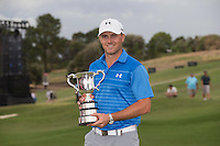 Jordan Spieth of the USA with the trophy after winning the Emirates Australian Open Golf