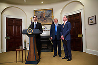 "United States Senator Tom Cotton (Republican of Arkansas) makes an announcement on the introduction of the Reforming American Immigration for a Strong Economy (RAISE) Act in the Roosevelt Room at the White House in Washington, D.C., U.S., on Wednesday, August 2, 2017. The act aims to overhaul U.S. immigration by moving towards a ""merit-based"" system.  Pictured at right are US President Donald J. Trump and Sen. David Perdue, a Republican from Georgia. Photo Credit: Zach Gibson/CNP/AdMedia"
