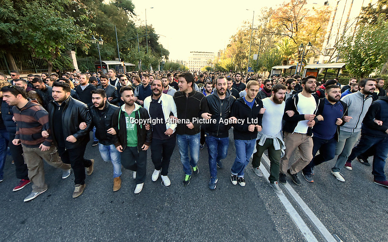 Pictured: A rally consisting mostly of young students parade through the city on its way to the US Embassy to mark the 43rd anniversary of the Polytechnic Uprising in Athens Greece. Thursday 17 November 2016<br /> Re: 43rd anniversary of the Athens Polytechnic uprising of 1973 which was a massive demonstration of popular rejection of the Greek military junta of 1967–1974. The uprising began on November 14, 1973, escalated to an open anti-junta revolt and ended in bloodshed in the early morning of November 17 after a series of events starting with a tank crashing through the gates of the Polytechnic.