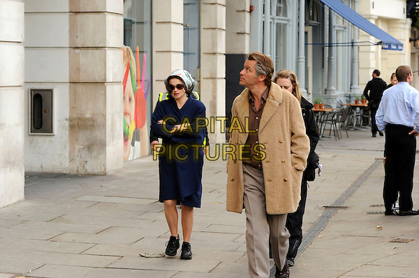 "Dominic West & Helena Bonham Carter .Filming on the set of ""Burton & Taylor"" in Central London , England. .18th April 2013.acting film movie full length beige grey gray trousers jacket shoes headscarf scarf blue profile looking up arms crossed .CAP/IA.©Ian Allis/Capital Pictures."